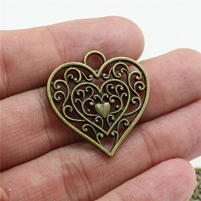 20pcs 2829mm hollow filigree heart charms antique bronze vintage 20pcs 2829mm hollow filigree heart charms antique bronze vintage metal zinc alloy trendy heart pendant for jewelry d0994 in charms from jewelry aloadofball Gallery