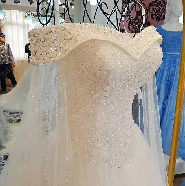فساتين زفاف فاخرة من الكريستال دبي 2019 قفطان مثير برقبة على شكل V رداء دي ماريج بأكمام طويلة عربي مسلم فساتين زفاف