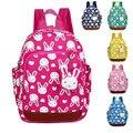 Bonito anti perdido mochila jardim de infância pequeno saco de algodão com pingente selo mochila uma geração