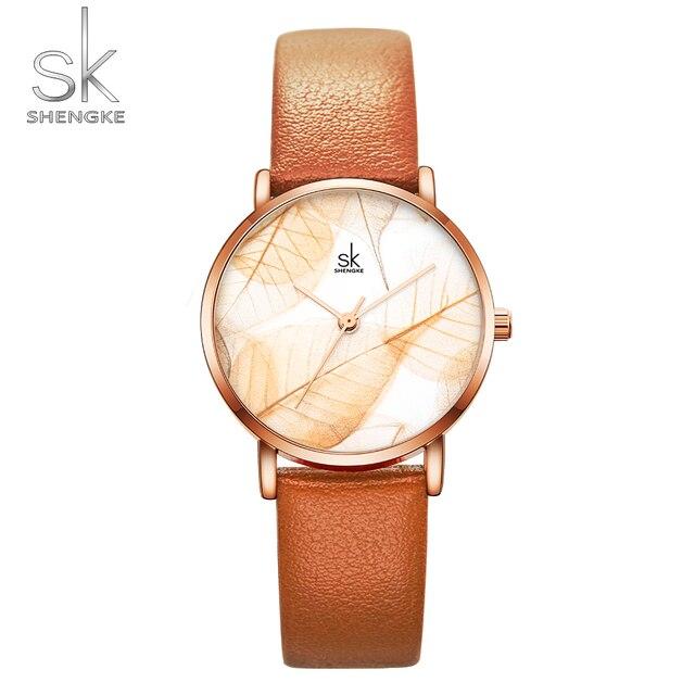 Shengke новый для женщин часы Творческий листья циферблат Яркий кожаный ремешок кварцевые часы, модный повседневное дамы наручные часы Montre Femme
