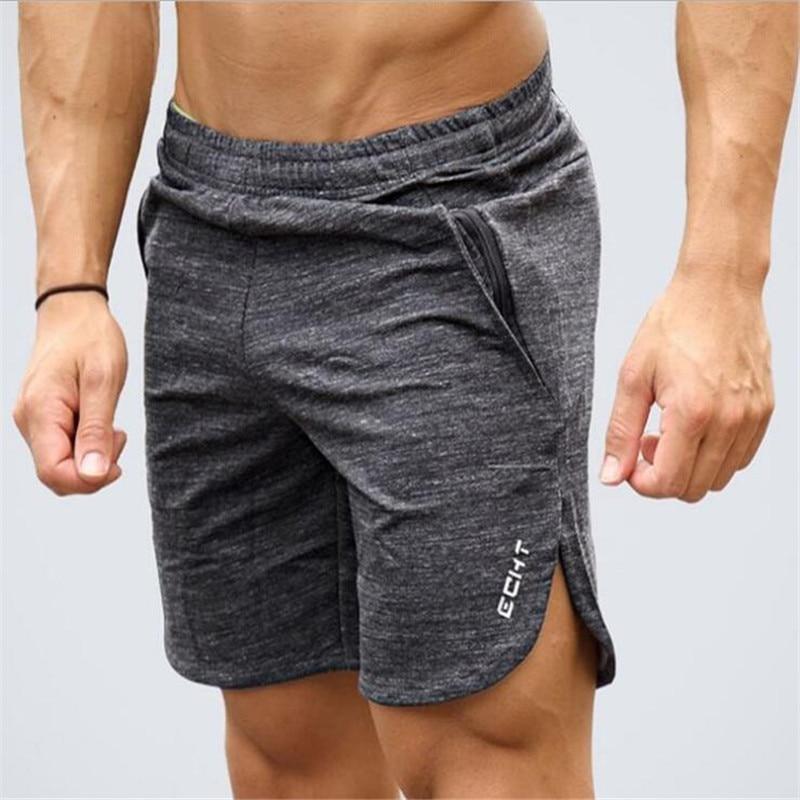 Los nuevos hombres de la moda deportiva playa pantalones cortos pantalones de algodón de culturismo pantalones Fitness corto Jogger de gimnasios pantalones cortos de hombres