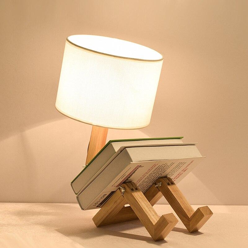 크리 에이 티브 로봇 모양 테이블 램프 led eu/au/us 플러그 유연한 가변 접는 독서 빛 나무 패브릭 침대 옆 램프 luminaria