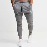 YEMEKE2017 the muscle male autumn and winter new fashion trend line casual sweatpants exercise gyms men fitness long pants