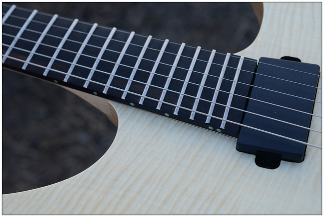 2019 NK Headless, Fanned Frets, clear Flame Maple top, Flame maple Neck, Ebony fingerboard, Black hardware  2