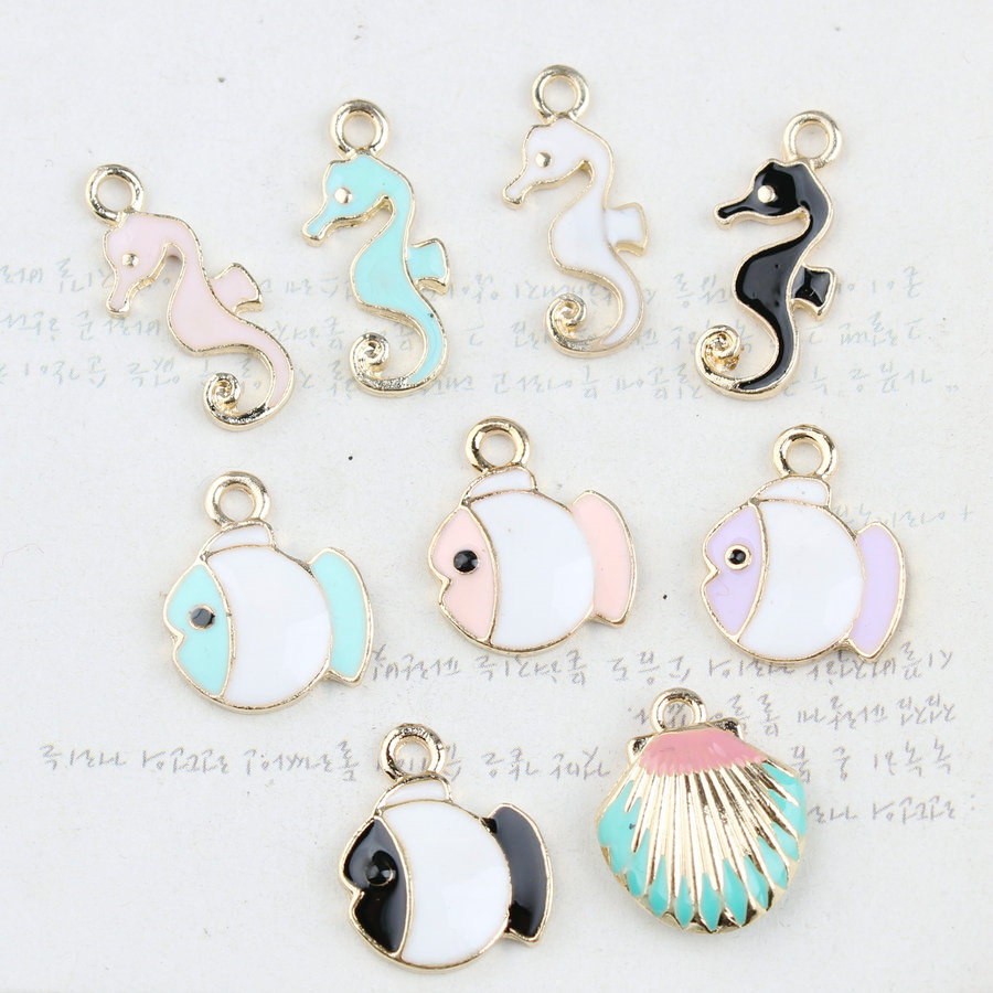 Wholesale 50pcs fashion animal sea horse fish shell enamel alloy diy wholesale 50pcs fashion animal sea horse fish shell enamel alloy diy jewelry pendant charms gold tone oil drop bracelet charm in charms from jewelry aloadofball Images