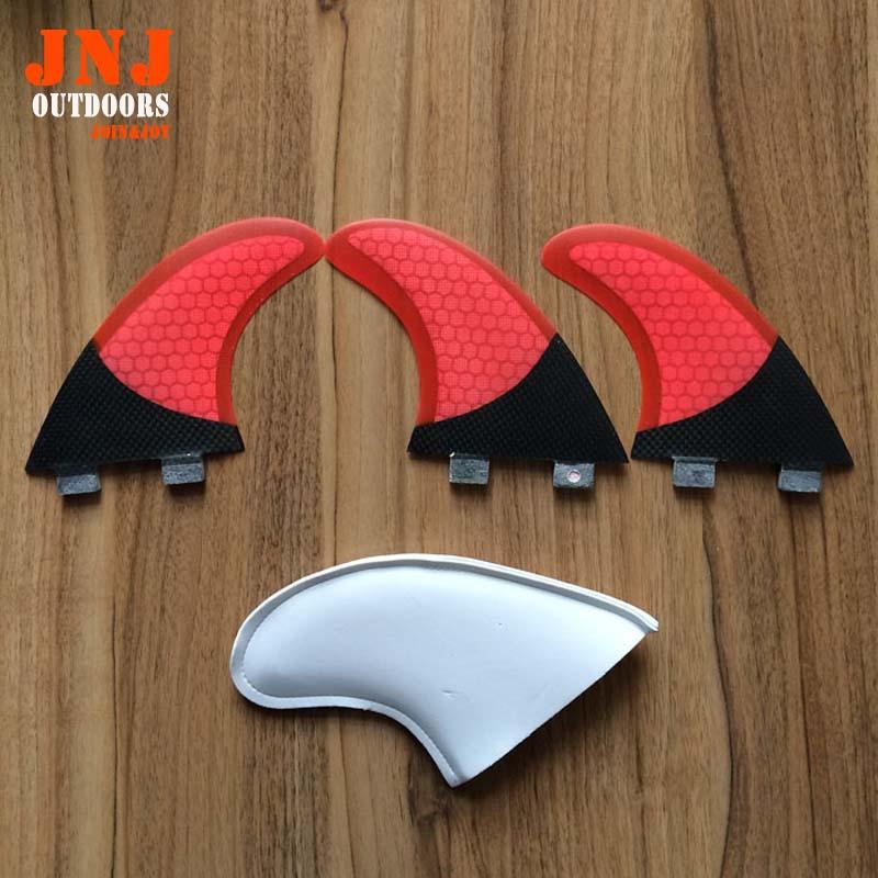 Tabla de surf de color rojo de fibra de carbono FCS G5 M aletas con panal