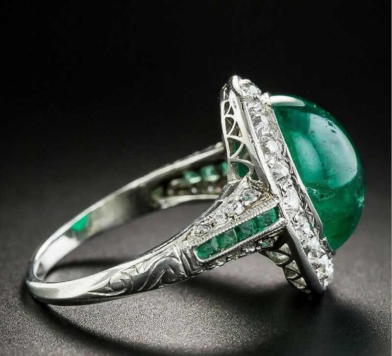 ファッション女性シルバーグリーン宝石石光沢のあるジルコンオーバル結婚指輪女性のためのクリエイティブパーティーリングギフトジュエリー RA381