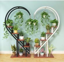 The living room household use pattern rack multilayer indoor special price balcony iron work circular buy content rack adornment
