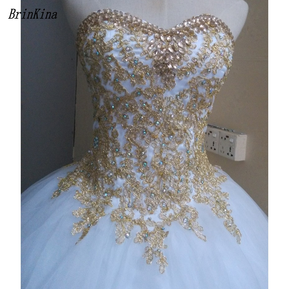 Brinkina Popular White Quinceanera Dress 15 anos Ball Gown Gold Lace Crystal 2018 Cheap Sweet 16 Dresses Debutante Gown