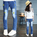 2017 spring and autumn hot fashion children's jeans 4-13 year old girl printed cartoon cat head self-cultivation wild stretch pa