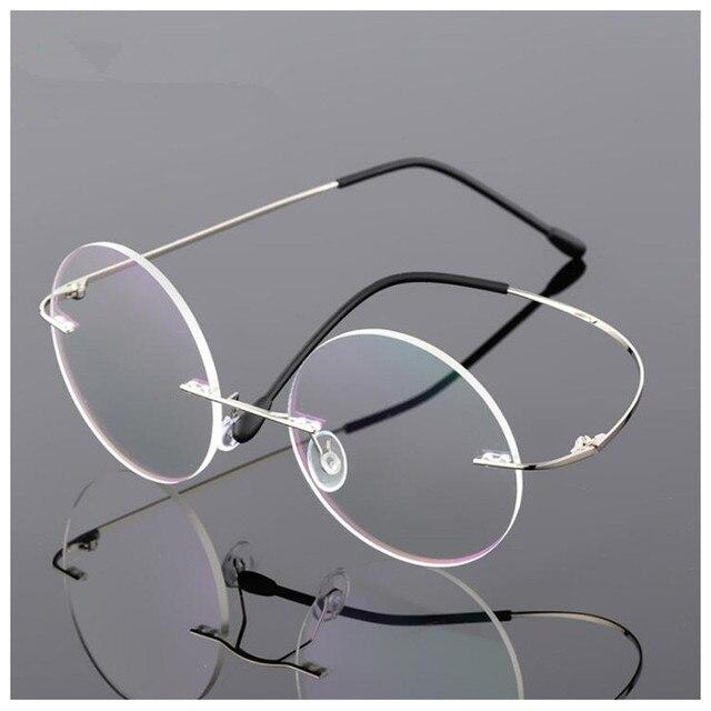 a716e18ae Flexível Peso leve Sem Aro de Titânio Miopia Vidros Ópticos Quadro Rodada  Óculos de Lente Clara