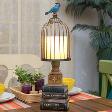 Retro Bird Standing On A Bird Cage Table Lamp Bedroom Bedside Lamp Sculpture Stacked Books Resin Decoration Lamp Abajur Led(China)