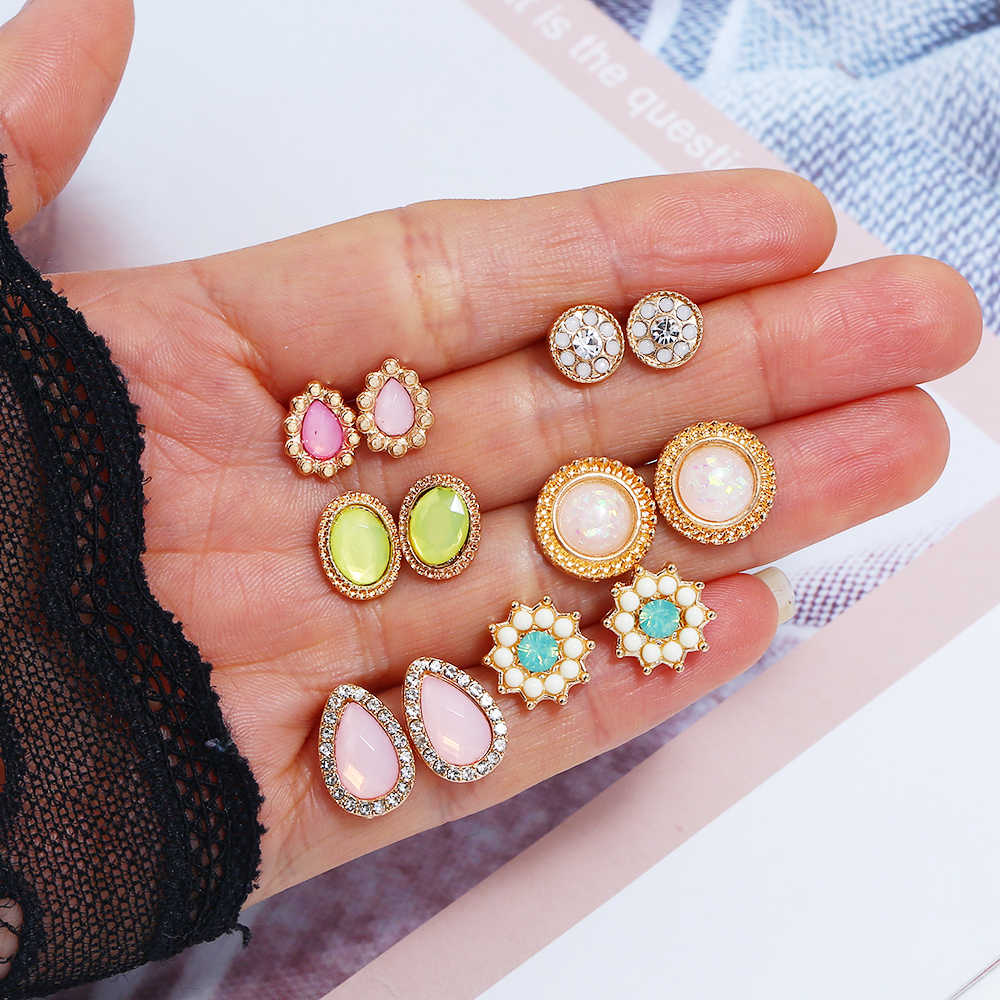pack of 6 pair stud earrings with rhinestone and acrylic resin flower design in gold tone
