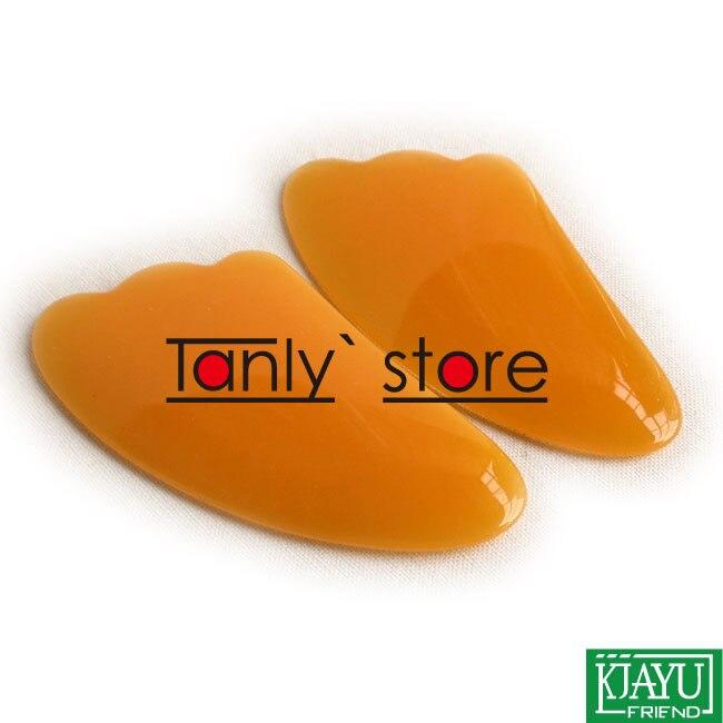 100 unids lote al por mayor y al por menor tradicionales acupuntura masaje  Herramientas triángulo amarillo resina guasha gráfico regalo 97c74c9f7d0