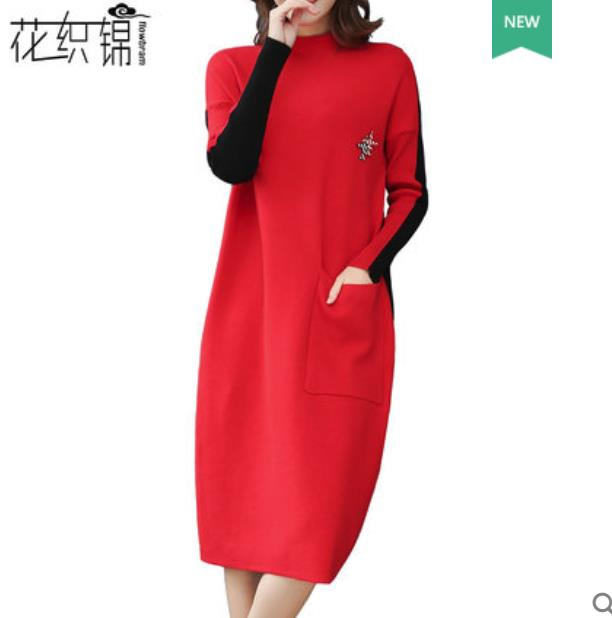 A long red knee length sweater skirt in a loose knit dress with a high neckline