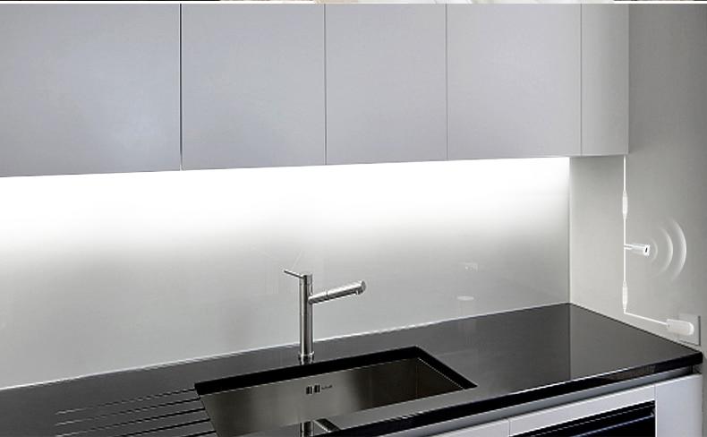 HTB1qy9DaUvrK1RjSspcq6zzSXXaW Hand Sweep Sensor LED Strips 12V Waterproof 1M 2M 3M 4M 5M Motion Sensor Night lights DIY Cupboard Wardrobe Closet Kitchen lamp