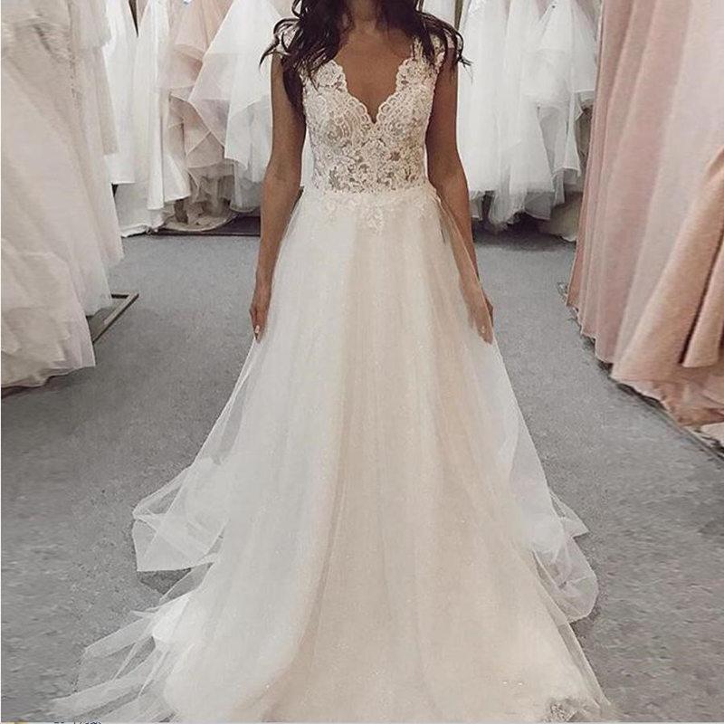 Wedding dress sleeveless A line v neck wedding dress tulle appliques floor length bridal gown white backless robe de mariee