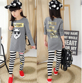 Free shipping Girls Long Sleeve white Wolf 1986 digits  long casual shirt girl T shirt