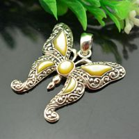 925 sterling silver yellow shell of carve patterns or designs on woodwork butterfly pendant female