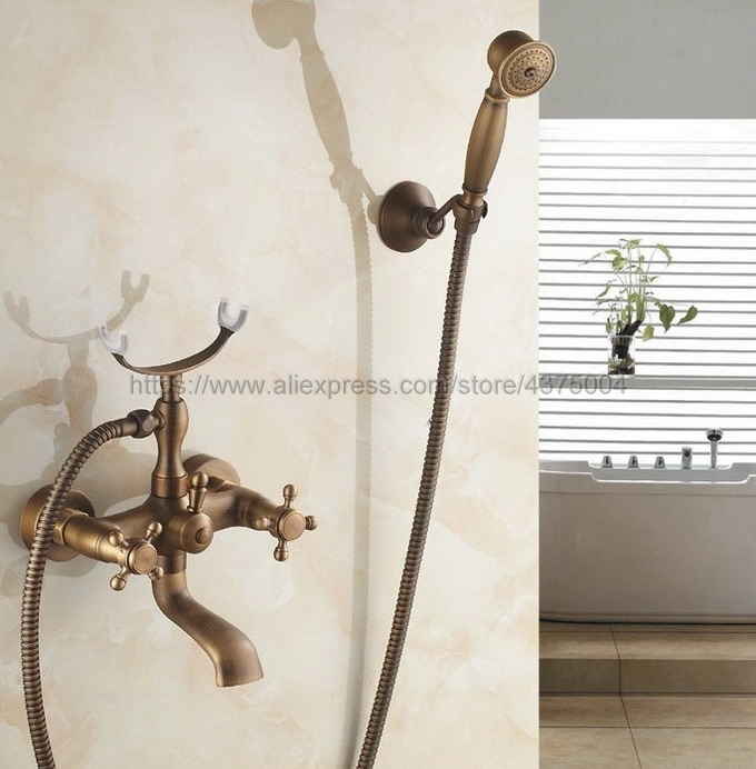 Antique Brass Bath Shower Faucet Set Dual Knobs Wall Mounted Bathtub Mixers with Handshower Swive Tub Spout Ntf155Antique Brass Bath Shower Faucet Set Dual Knobs Wall Mounted Bathtub Mixers with Handshower Swive Tub Spout Ntf155