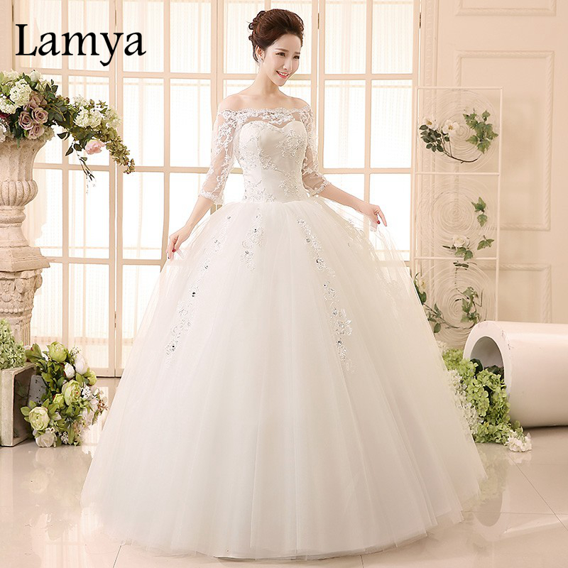 Lace bridal ball gown tutu crystal wedding dress lamya for Princess plus size wedding dresses