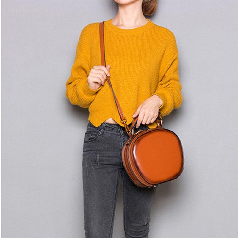 2018 novas Mulheres couro Genuíno bolsas slung minimalista retro feminino bolsa de ombro pacote diagonal mensageiro mini saco rodada