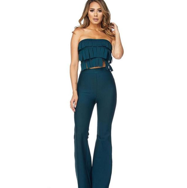 86708bd2718d Europe Fashion Women Clothing Two Piece Set 2018 Sexy Off Shoulder Tassel  Crop Top Flare Pants Suit Party Clubwear 2 Piece Set