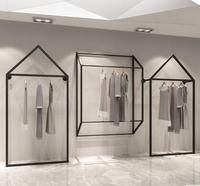 Simple clothing racks. Clothing store display rack walls. Women's shop shelves. Hangers. Clothes hangers.055