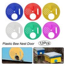 12 piezas ronda de colmena de la abeja de puerta de entrada de disco de plástico nido de abejas Puerta de nido de abeja puerta de entrada de la apicultura herramienta equipo