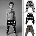 2016 Baby Boy Pantalones Harem Niños Niñas Cross Patrón de Estrella muchachos Choses 100% Algodón Niñas niños Pantalones 9 M-3Years Bebé Pantalones