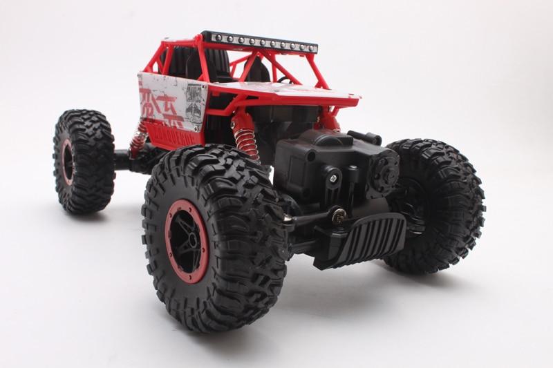 RC-auto 2,4 GHz: n rock-telaketjuralli-auto 4WD -kuorma-auto 1:18 mittakaava maastoajoneuvojen viallinen elektroninen kaukosäätimen mallilelu 1801