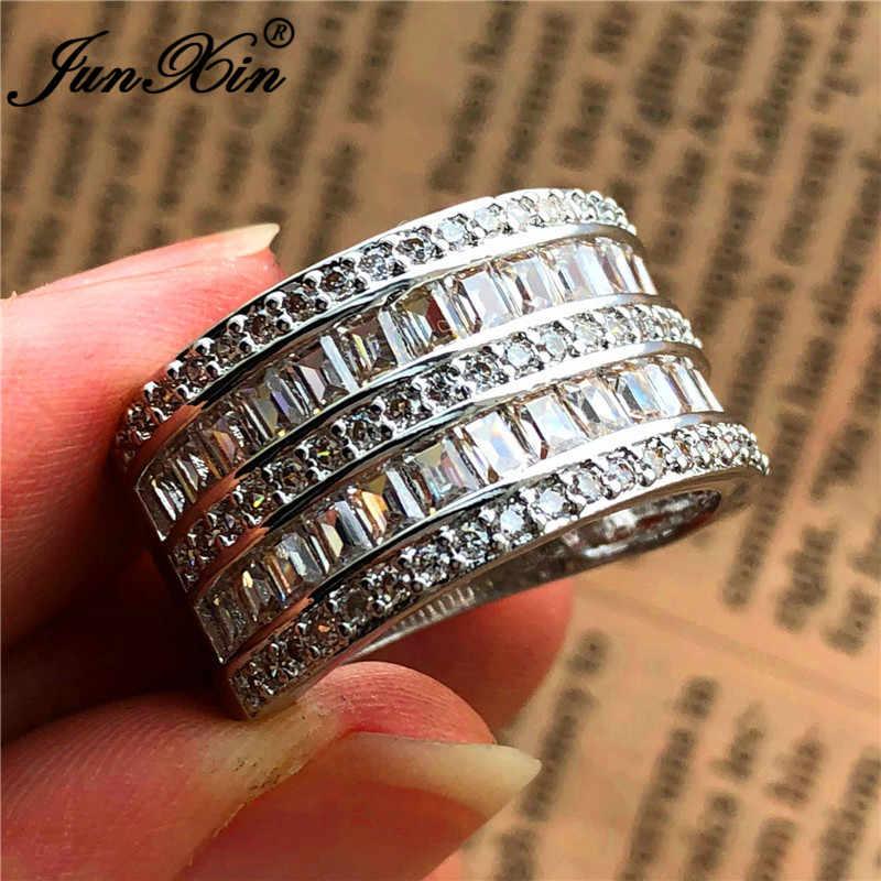 JUNXIN Luxury หญิงชายคริสตัลงานแต่งงานแหวนเงิน 925 สีสีขาว Zircon หินกว้างหมั้นแหวนเครื่องประดับ