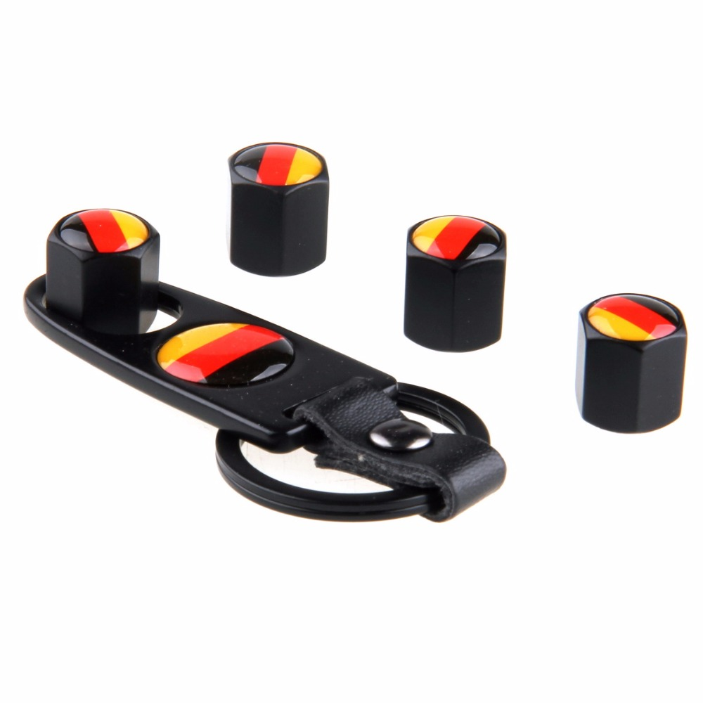 Cabeza engranaje coche estilo bandera alemana acero inoxidable negro 4 piezas neumático hermético neumático Stem aire válvula tapas con llavero