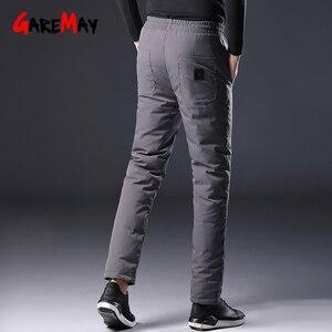 Image 3 - Homem inverno para baixo calças masculinas de pato branco para baixo calças de homem streetwear inverno engrossar quente preto bolsos casuais dos homens para baixo