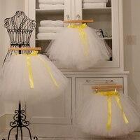 Blanco puro falda de tutú cintura elástica con amarillo Cintas cinturón una línea de longitud de rodilla falda tulle Faldas mujeres
