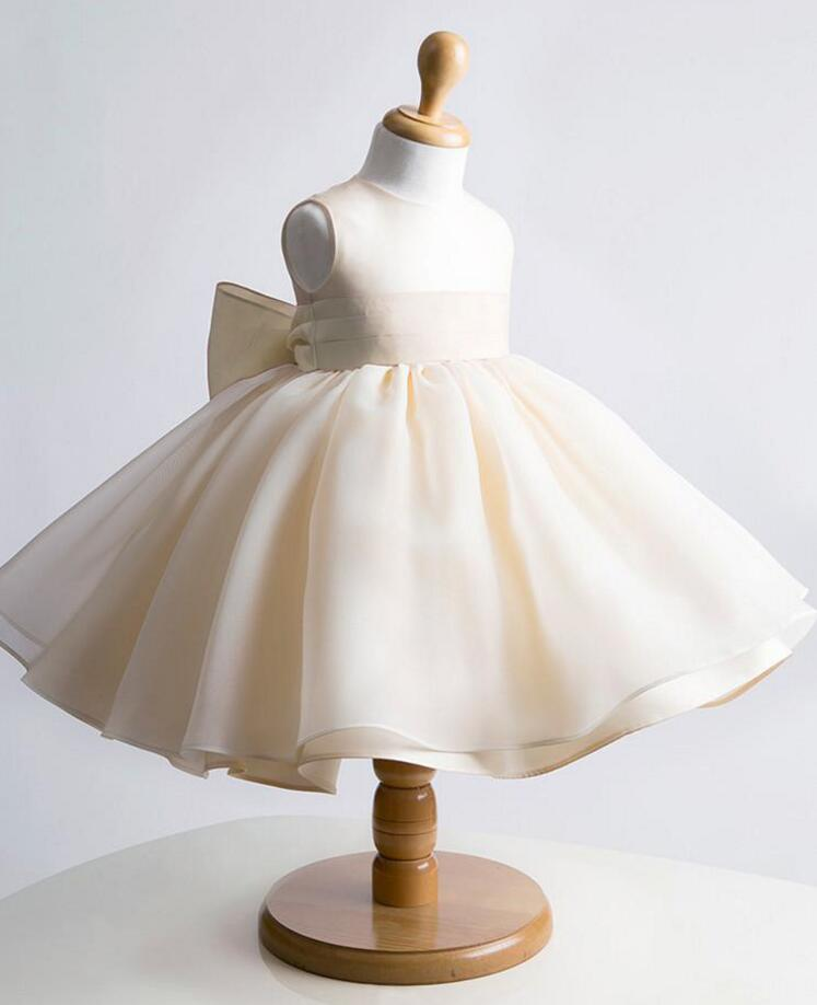 Cute cheap Champagne knee-length organza flower girl dress with big bow ball gown toddler wedding party first communion gown hot sale champagne lace appliques first communion dress ball gown with bow kids evening gown flower girl dress for wedding