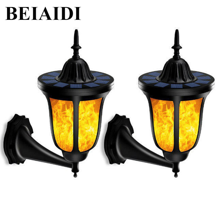 BEIAIDI 2PCS Solar Power Flickering Flame Wall Light 96 LED Outdoor Dancing Flame Night Light Waterproof Fence Garden Wall Lamp hot 96led solar powered flame flickering wall light vintage lamp outdoor waterfproof garden fence door corridor decor