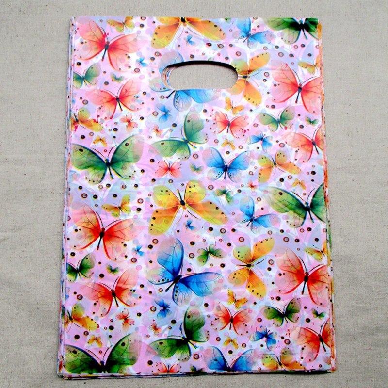 c39058e10fd39 100 قطعة الوحدة متعددة الالوان الفراشة البلاستيك بوتيك عودة هدية الحقائب  التسوق هدية حزمة حقيبة 25 20cm153513
