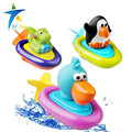 2016 nuevo bebé del juego de niños juguetes juguetes de baño flotante de rally en el agua barco nadando clockwork dabbling juguete juguetes de cuerda tipo de rueda