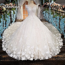 LS00174 vestido de noiva see through back beading short sleeves lace ball gown cathedral train Luxury wedding dresses real photo(China)