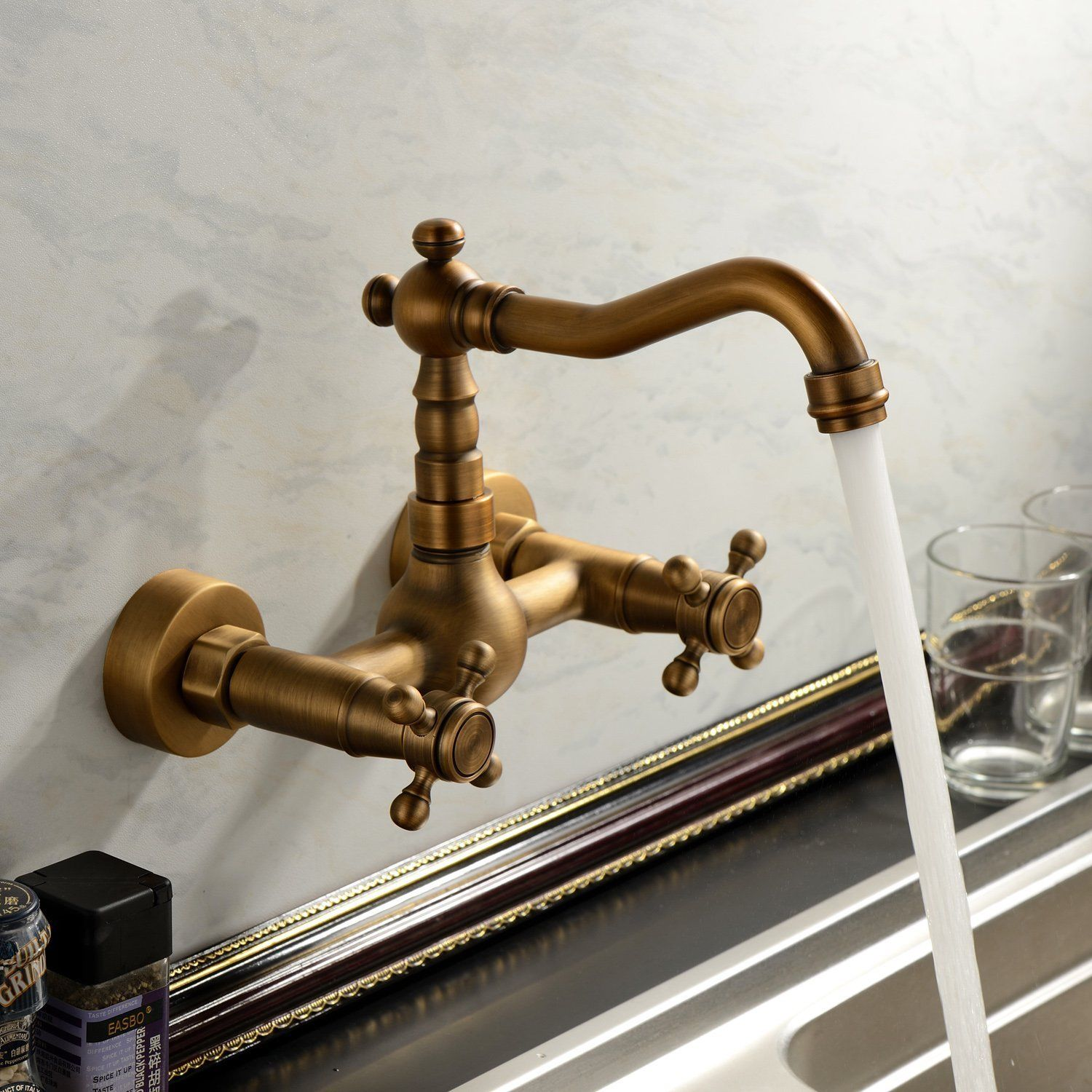 Antique Brass Wall Mounted Swivel Spout Bathroom Sink Faucet Double Handle Mixer Tap ZD515
