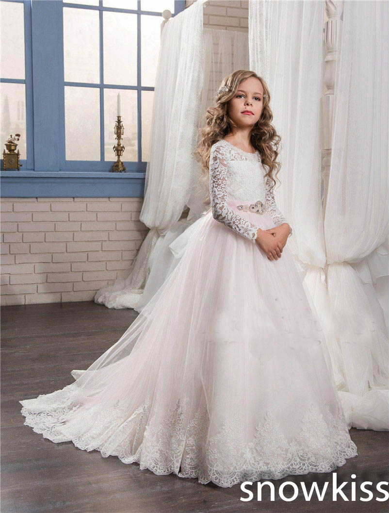 White/ivory cheap cute first communion dresses with train long sleeve ball gown flower girls dress for wedding with bow cute new long sleeves white ball gown flower girl dresses french lace beaded first communion dress with sequin bow and sash