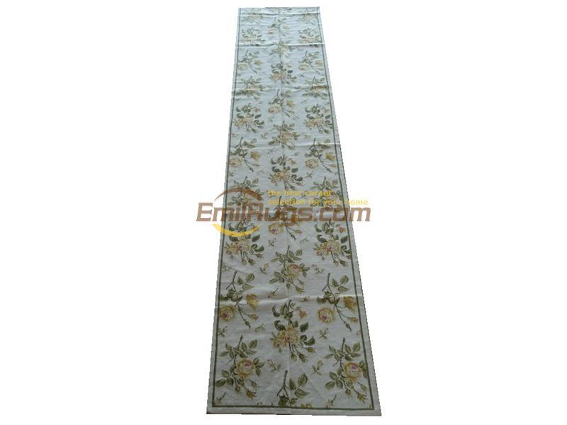 Les tapis à aiguille de chine sont des tapis de coureur à aiguille en laine cousus à la main au musée