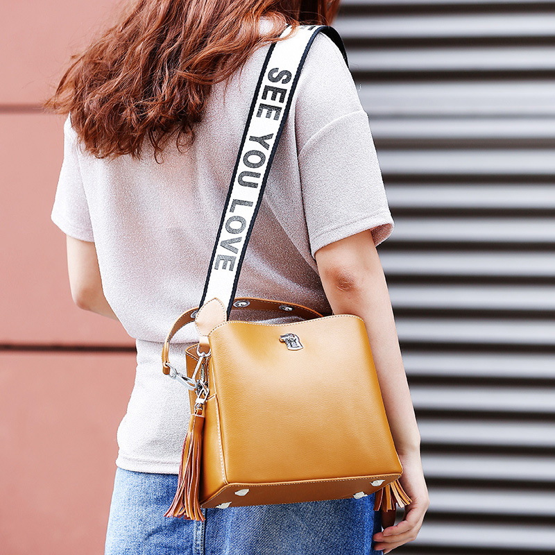 THREEPEAS new female bag European and American style tassel bucket bag female Cow leather Messenger shoulder bag wide straps hansomfy womens handbags solid patent leather shoulder bag european and american style versatile female vintage bucket brand bag