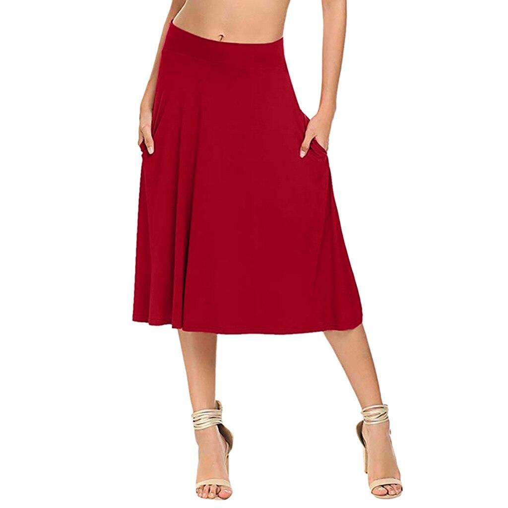 6b6dd85e6 Las mujeres sólido básico elástico imperio Casual falda cintura alta  llamarada bolsillos una ...
