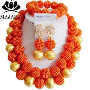 Модный комплект ювелирных изделий из африканских бусин на свадьбу в нигерийском стиле, набор ювелирных изделий из оранжевых бусин, ожерель...