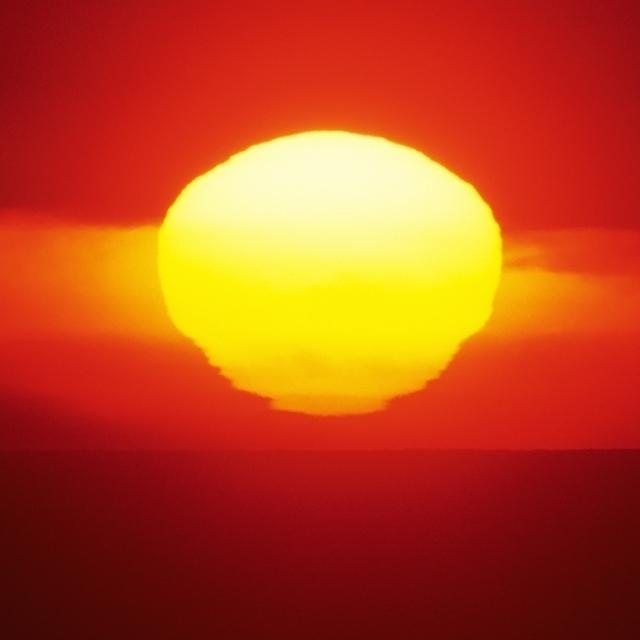 Gorgeous Sun Setting In Bright Orange Sky Over Ocean. Poster Print (34 x 22)