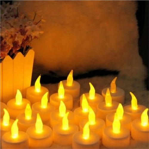 New Flickering Amber 24 pack Light Flameless LED Tealight Tea Candles Wedding