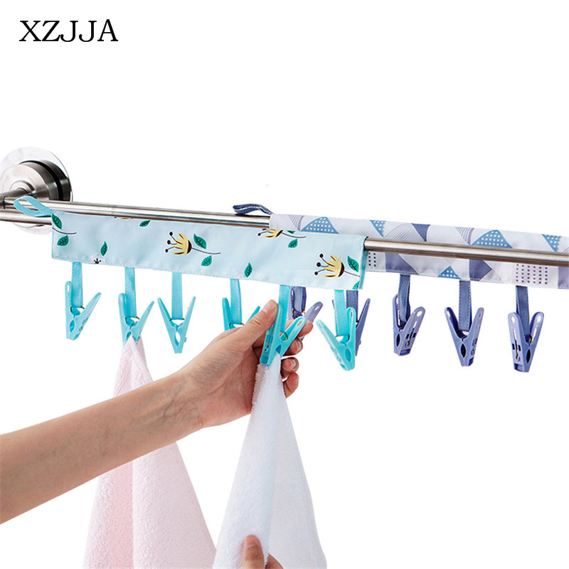 XZJJA 1PCS Creative Folding Cloth Hanger 6 Clip Bathroom Rack Portable Traveling Clothespin Underwear Socks Organization Clip