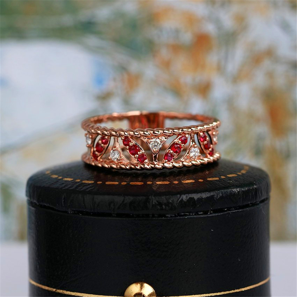 Stylish lady rose gold hollow-out design set with red and white premium zircon engagement ring.Suitable for party weddings.(China)